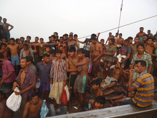 Suspected human trafficking victims are crammed on a Thai trawler, which was rescued by the Bangladesh Coast Guard, in southern Bangladesh on June 11, 2014, in this handout picture provided by the Bangladesh Coast Guard. REUTERS/Bangladesh Coast Guard/Handout via Reuters